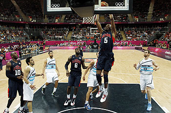 Kevin Durant (centre) of the US dunks against Argentina during their men's preliminary round Group A basketball match at the Basketball Arena on Monday