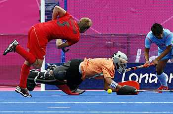 Belgium's Jerome Dekeyser scores against India