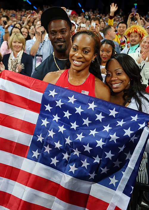 Sanya Richards-Ross of the United States celebrates with her family on winning gold in the Women's 400m final on Sunday