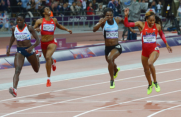 Sanya Richards-Ross of the United States crosses the finish line ahead of Christine Ohuruogu of Great Britain to win the Women's 400m final on Sunday