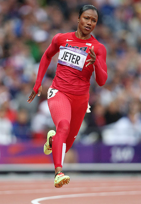 Carmelita Jeter of the United States runs in the Women's 200m heat on Monday