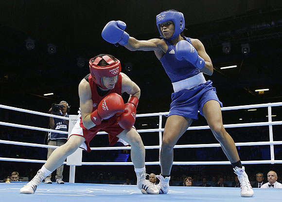 Ireland's Katie Taylor (left) ducks a punch from Britain's Natasha Jonas in a women's lightweight 60-kg quarter-final boxing matchon Monday