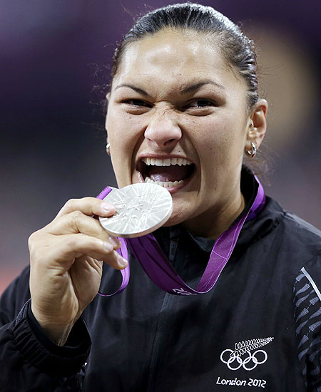 New Zealand's Valerie Adams holds her silver medal for women's shot put during the athletics in the Olympic Stadium on Monday