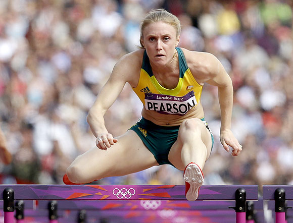 Australia's Sally Pearson competes in a women's 100-meter hurdles heat on Monday