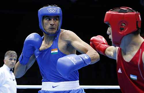 Uzbekistan's Abbos Atoev fights India's Vijender during their quarterfinal Men's Middle (75kg) boxing match at the London Olympic Games