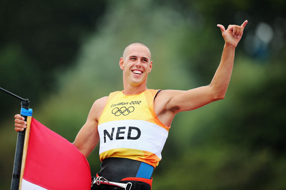 Dorian Van Rijsselberge of Netherlands celebrates after winning gold in the Men's RS:X Sailing