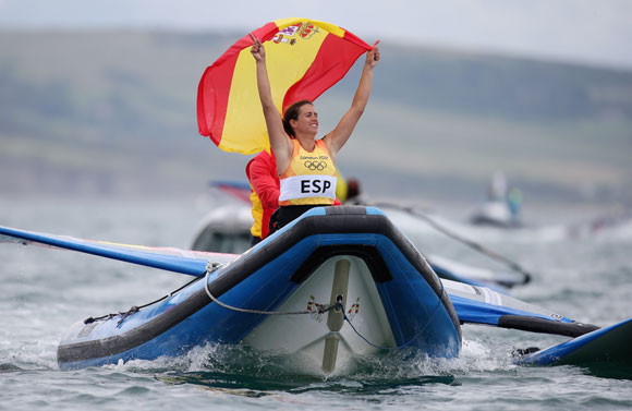 Marina Alabau Neira of Spain celebrates winning the gold medal in the RS:X Women's Sailing