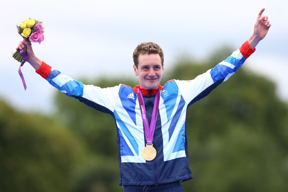 Alistair Brownlee of Great Britain celebrates with his gold medal during the medal ceremony for the Men's Triathlon