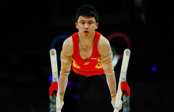 China's Feng Zhe competes in the men's gymnastics parallel bars final in the North Greenwich Arena