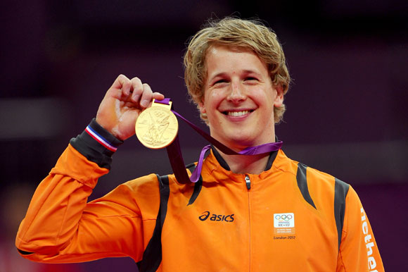 Gold medalist Epke Zonderland of Netherlands poses on the podium after the Artistic Gymnastics Men's Horizontal Bar final