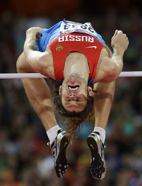 Russia's Ivan Ukhov clears the bar in the men's high jump final during the athletics in the Olympic Stadium
