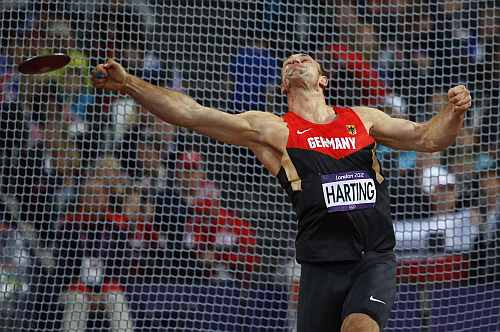 Germany's Robert Harting takes a throw in the men's discus throw final during the athletics in the Olympic Stadium