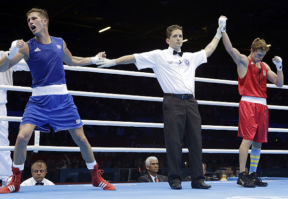 Alexis Vastine of France (left) reacts after the referee names Taras Shelestyuk of Ukraine, as the winner after their welterweight 69-kg quarter-final bout on Tuesday