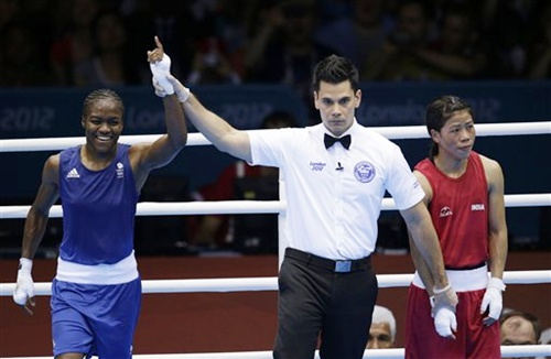 Great Britain's Nicola Adams, left, and India's MC Mary Kom
