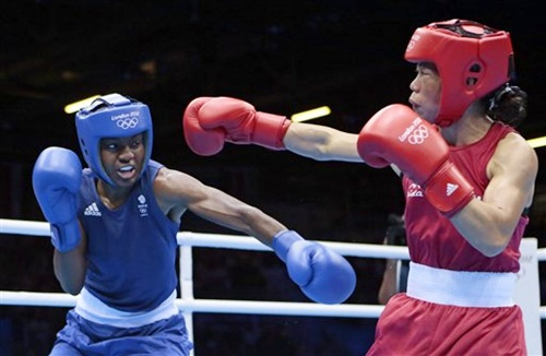Great Britain's Nicola Adams, left, and India's Mary Kom
