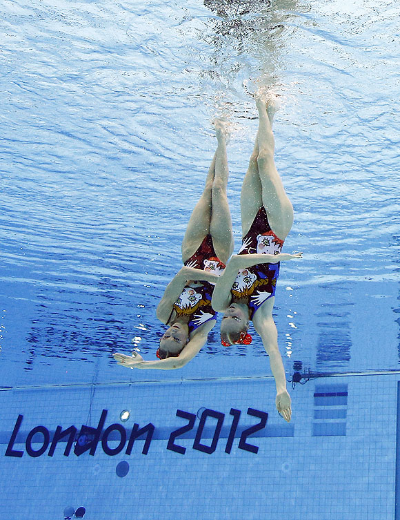 Natalia Ishchenko and Svetlana Romashina of Russia compete during women