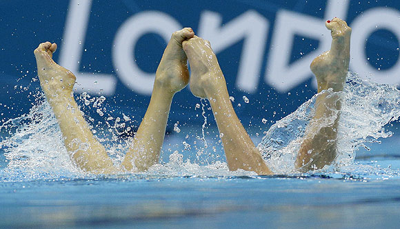 Natalia Ishchenko and Svetlana Romashina from Russia compete during the women's duet synchronized swimming free routine
