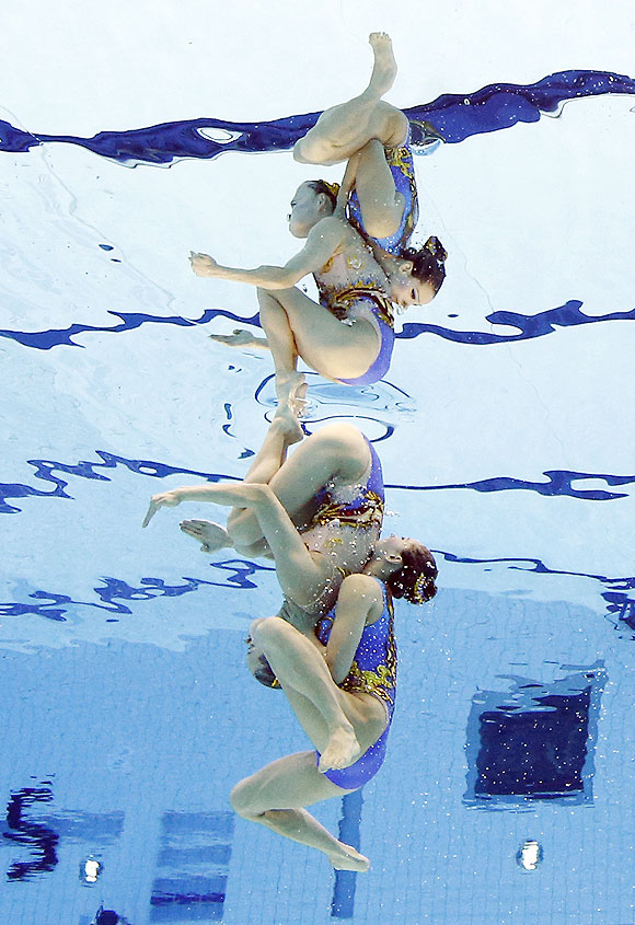 Huang Xuechen and Liu Ou of China compete during women's duet synchronized swimming final on Tuesday