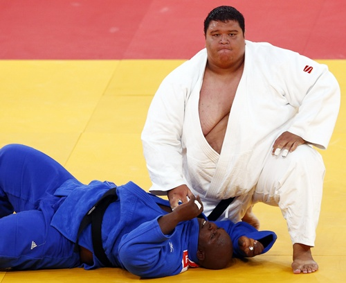 Guam's Ricardo Blas Jr. (right) looks up