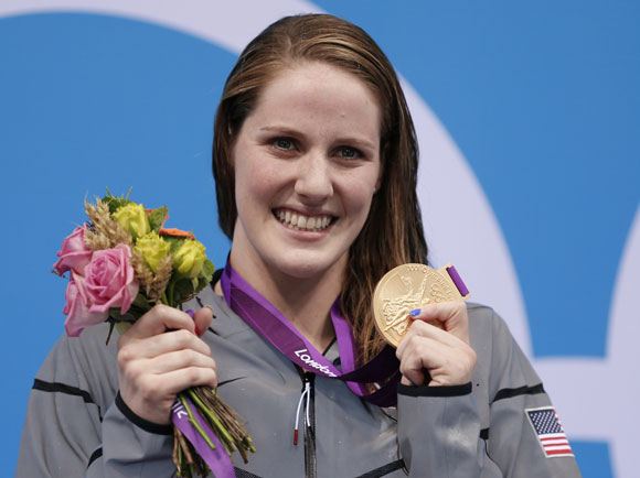 Gold medallist Missy Franklin of the U.S., who set a new world record, poses at the women's 200m backstroke victory ceremony