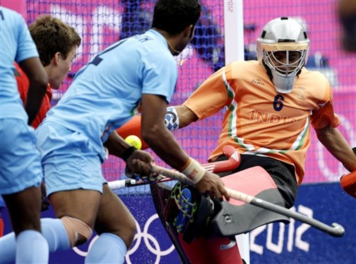 India goalkeeper Bharat Chetri can't stop a goal by Belgium's Tom Boon