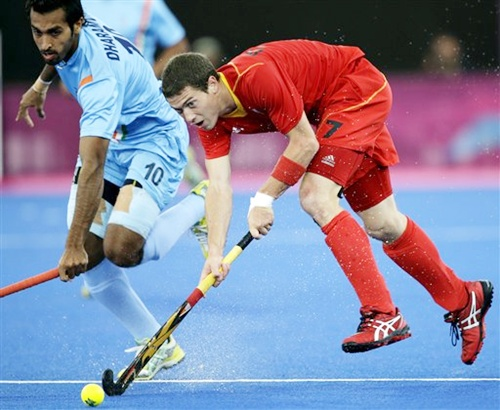 Belgium's John-John Dohmen (7) and India's Dharamvir Singh (10) battle for control of the ball