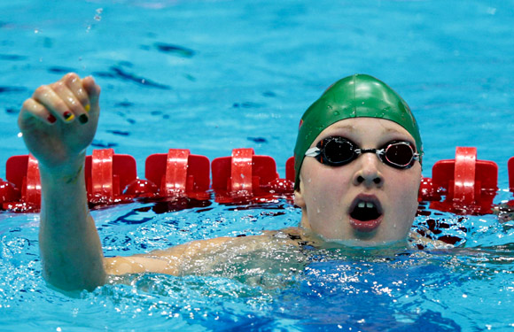 Lithuania's Ruta Meilutyte reacts after competing in the Women's 100m Breaststroke