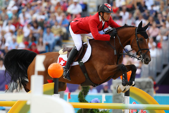Steve Guerdat of Switzerland riding Nino Des Buissonnets competes in the Individual Jumping Equ