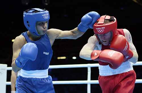Ireland's Paddy Barnes, right, fights India's Devendro Singh Laishram in a light flyweight 49-kg quarterfinal boxing match at the 2012 Summer Olympics
