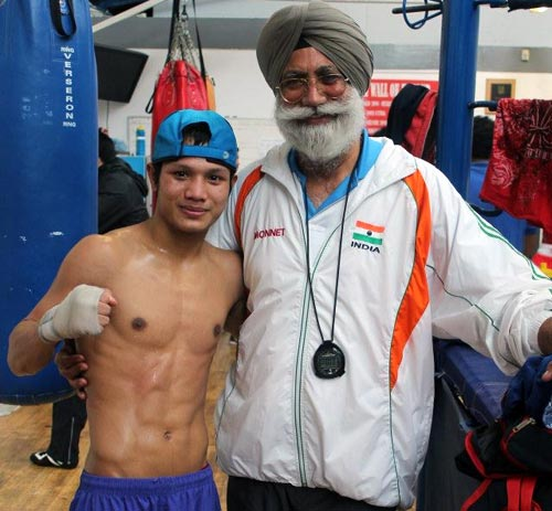 Coach Gurbax Singh Sandhu with boxer Devendro Singh