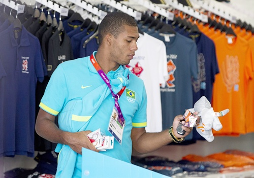 Brazilian Olympic footballer Juan Jesus shops in a store in the Athletes Village