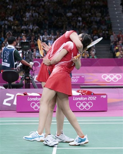 India's Jwala Gutta, left, and Ashwini Ponnappa celebrate