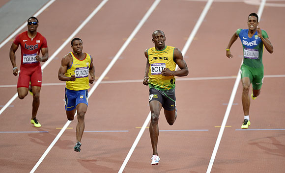 Jamaica's Usain Bolt crosses the finish line ahead of United States' Isiah Young (left), Ecuador's Alex Quinonez and Brazil's Aldemir Da Silva Junior (right) in the men's 200-meter semi-final on Wednesday
