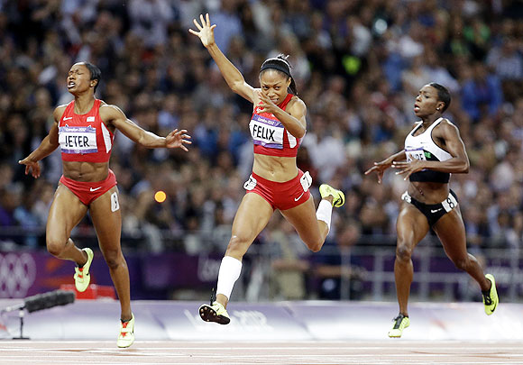 United States' Allyson Felix crosses the finish line to win the women's 200-meters final on Wednesday