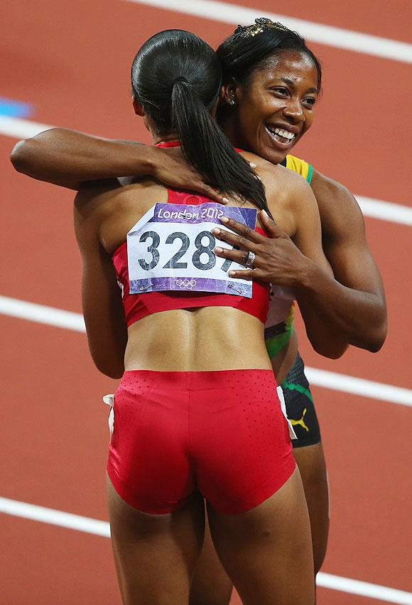 Silver medalist Shelly-Ann Fraser-Pryce hugs gold medalist Allyson Felix after the women's 200m final on Wednesday