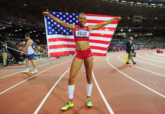 Allyson Felix of the United States celebrates after winning gold in the Women's 200m Final