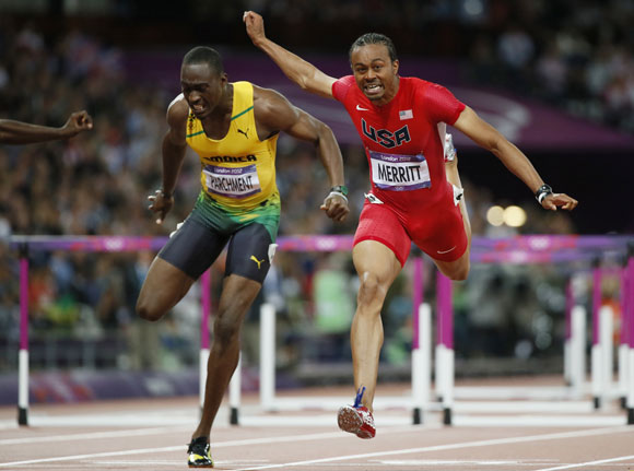 Aries Merritt of the U.S. (R) finishes first of Jamaica's Hansle Parchment during their men's 110m hurdles final