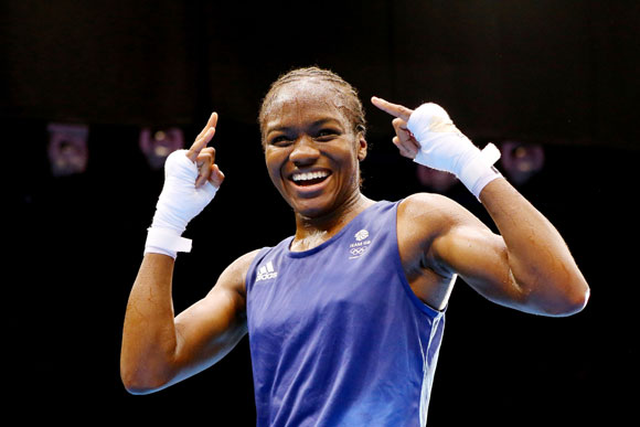Nicola Adams of Great Britain celebrates winning her bout against Cancan Ren of China during the Women's Fly (51kg) Boxing final bout