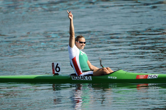 Danuta Kozak of Hungary celebrates winning the gold medal in Women's Kayak Single (K1) 500m Sprint