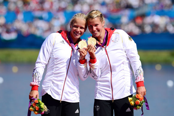 Franziska Weber and Tina Dietze of Germany celebrate winning the Gold medal in the Women's Kayak Double (K2) 500m Sprint