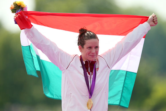 Gold medalist Eva Risztov of Hungary celebrates after winning the gold medal in the Women's Marathon 10km Swimming at Hyde Park