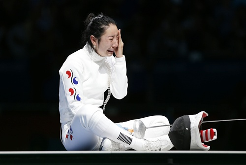 South Korea's Shin A Lam reacts after being defeated by Germany's Britta Heidemann