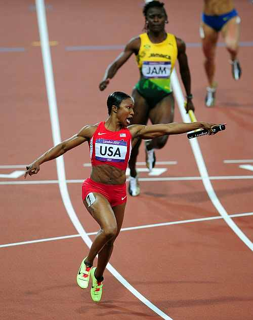 Carmelita Jeter of the United States celebrates winning gold in the Women's 4 x100m Relay Final