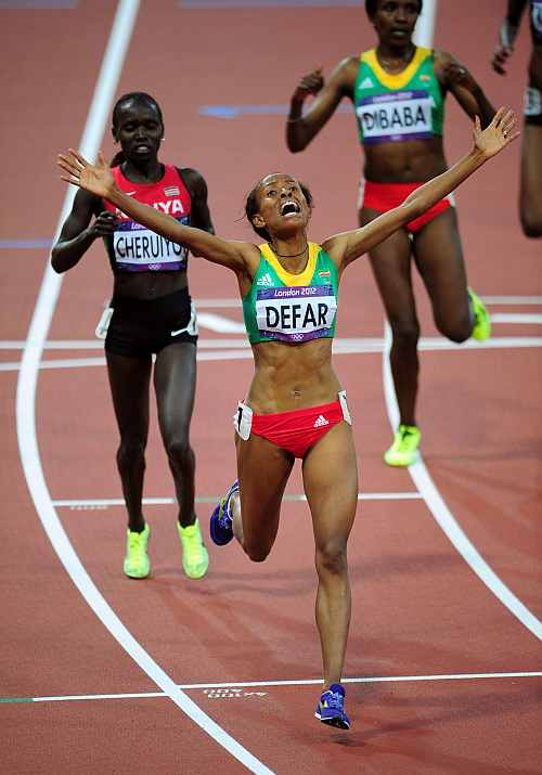 Meseret Defar of Ethiopia celebrates winning gold in the Women's 5000m Final