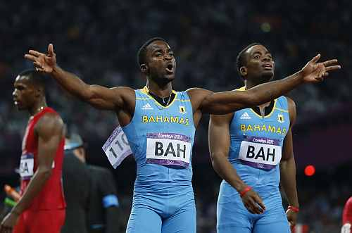 Bahamas' Ramon Miller (L) and Michael Mathieu celebrate winning the men's 4x400m relay final