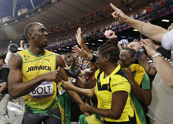 Usain Bolt celebrates his 200m victory with fans on Thursday
