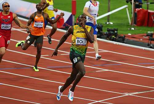 Usain Bolt of Jamaica celebrates as he crosses the finish line to win gold during the Men's 200m final