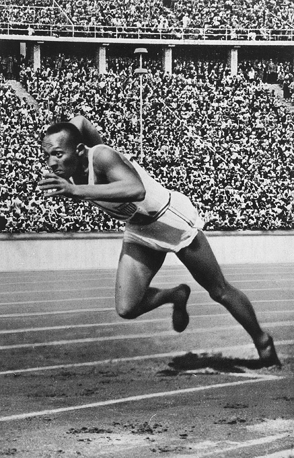 Jesse Owens of the USA at the start of the 200 metres at the 1936 Berlin Olympics which he won in 20.7 seconds, an Olympic record