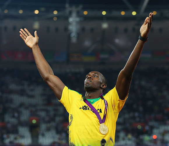 Gold medalist Usain Bolt of Jamaica celebrates during the medal ceremony on Thursday