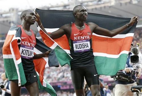 Kenya's David Lekuta Rudisha, right, and his teammate Timothy Kitum celebrate